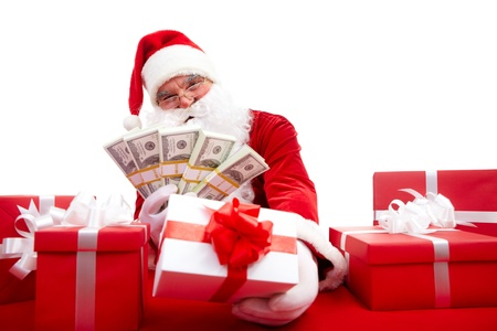 Photo of happy Santa Claus selling Christmas gifts and looking at camera photo