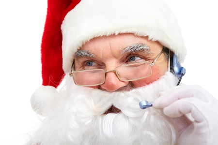 Photo of Santa Claus with headset talking to somebody photo