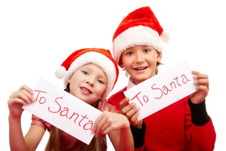 Happy children holding letters with note �To Santa� Stock Photo - 11426029