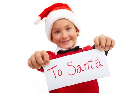 Happy lad holding letter with note 'To Santa' in isolation photo