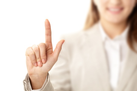 woman pointing up: Photo of female hand with forefinger pointing upwards