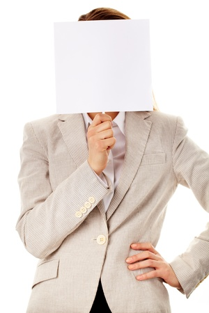 Image of elegant female holding empty paper close to her face photo