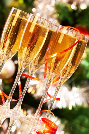 champagne flutes: Several champagne flutes on Christmas background