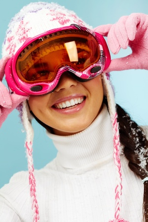 goggle: Happy woman in goggles and knitted winter cap