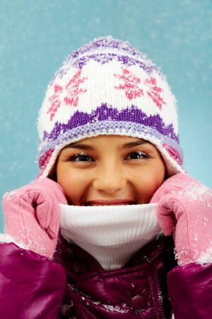 Pretty woman in winter clothes looking at camera with smile photo