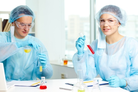 Two clinicians studying new substance in laboratory photo