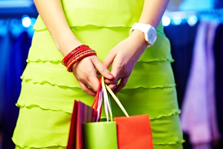 personal shopper: Image of shopaholic hands with three shopping bags
