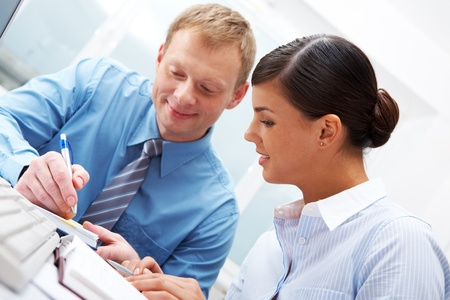 Manager showing plans to his female subordinate  Stock Photo - 11448696