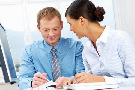 Two office workers making plans for the following week Stock Photo - 11448694