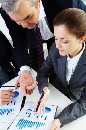 Image of business people working with documents  photo