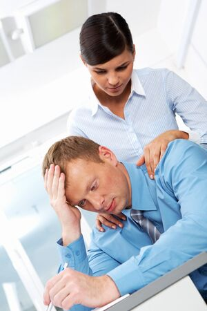 Portrait of business leader in trouble with young employee reassuring him Stock Photo - 11448690