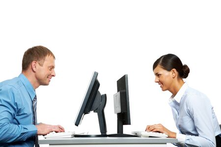 Two business colleagues sitting opposite at their monitors Stock Photo - 11448686