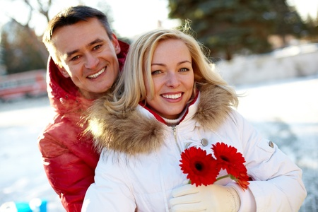 Photo of happy man and woman outdoor in winter photo