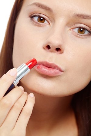 Fresh girl applying red lipstick and looking at camera Stock Photo - 11621898