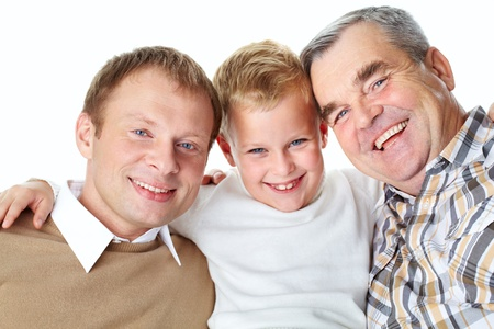 Portrait of a father, grandfather and son embracing photo