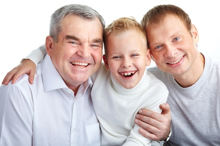 Portrait of joyful father, grandfather and son looking at camera photo