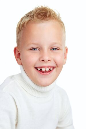 Portrait of cute boy smiling while looking at camera Stock Photo - 11621921