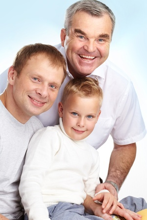 Portrait of father, grandfather and son looking at camera with smiles photo