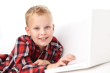 Portrait of cute boy typing and looking at camera Stock Photo - 11621926