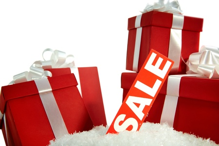 christmas sale: A heap of Christmas gifts in snow with sale tag near by Stock Photo