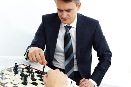 checkmate: Image of businessman thinking while playing chess Stock Photo