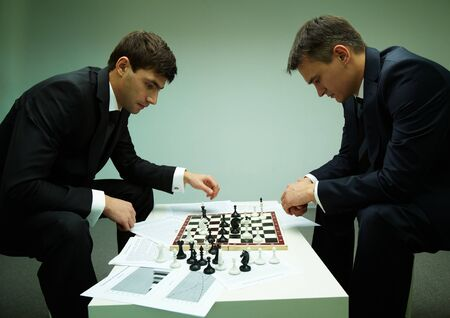 Image of two businessmen thinking of move while playing chess Stock Photo - 11622070