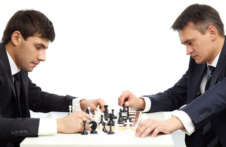 Image of two businessmen thinking of move while playing chess photo