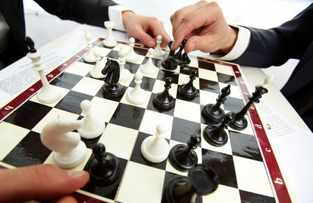 Image of human hand with chess figure making move Stock Photo - 11622083