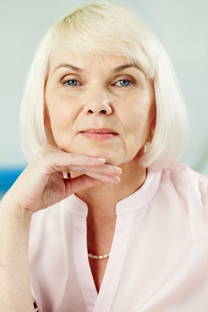 pensionary: Portrait of mature blond female looking at camera