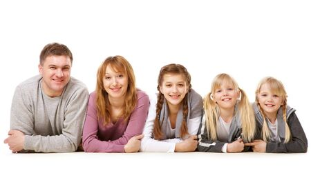 A young friendly family looking at camera on white background photo
