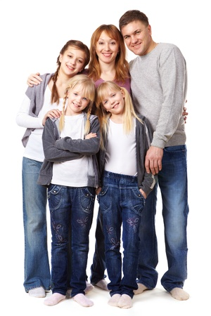 standing in line: A young friendly family looking at camera on white background