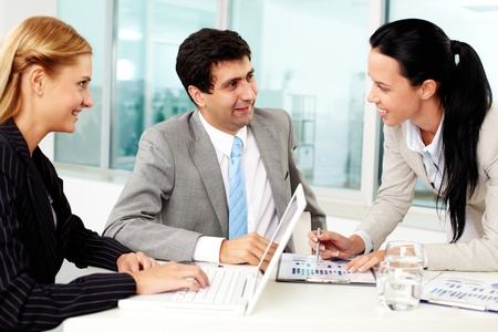 Three business people discussing ideas at workplace in office Stock Photo - 11633995