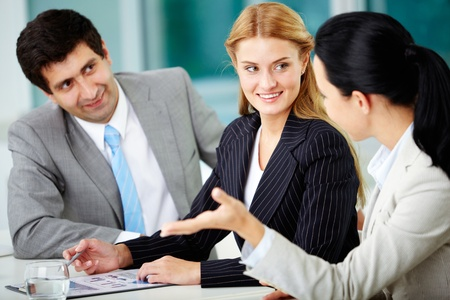 Three business people discussing new project in office Stock Photo - 11634003