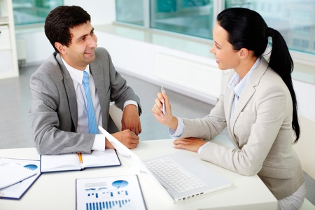 Confident businesswoman explaining her ideas to employer at meeting Stock Photo - 11634009