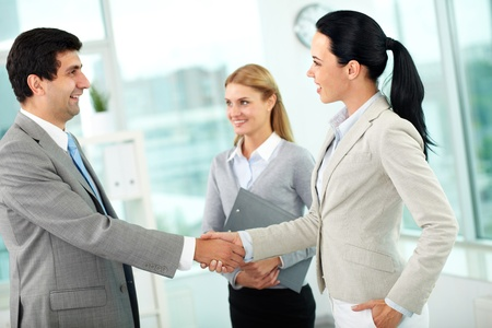 handshaking: Portrait of successful partners handshaking after signing contract Stock Photo