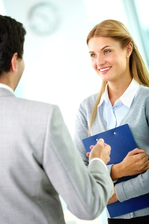 Portrait of happy businesswoman looking at her partner while interacting with him Stock Photo - 11633963