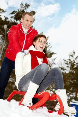 Portrait of happy couple in warm clothes having winter vacation photo