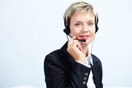 Portrait of customer service representative answering a call photo