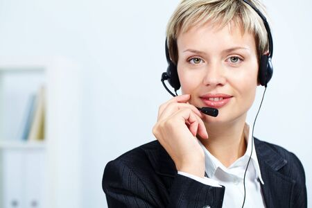 Portrait of attractive receptionist with headset photo