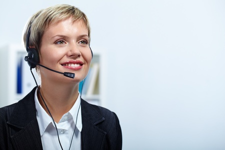 answering call: Portrait of friendly customer service representative during work