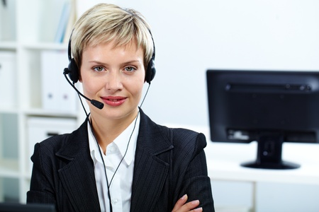 Portrait of customer service operator with headset looking at camera photo