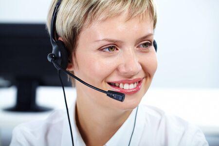 Portrait of friendly customer service representative smiling photo