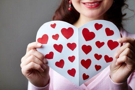 Close-up of female hands holding valentine card photo