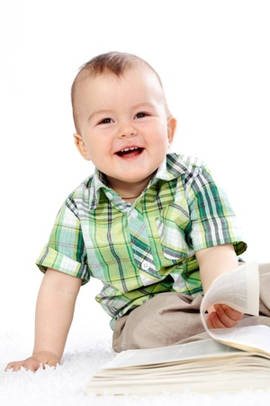 Portrait of happy boy with open book over white background photo