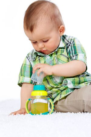 Portrait of calm boy with small bottle of drink near by Stock Photo - 11920615