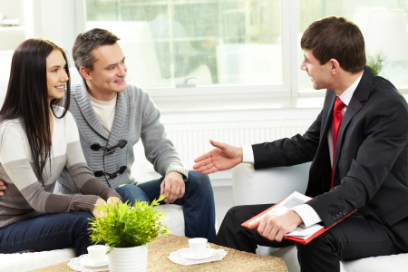insurance consultant: Portrait of modern couple listening to manager explanation about conditions of mortgage