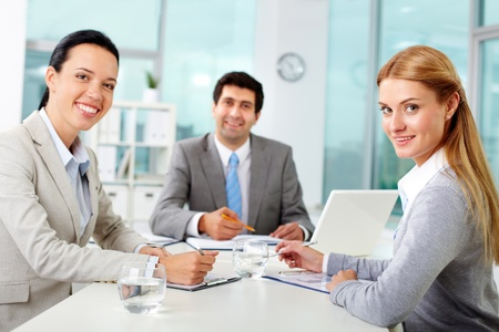Three business people looking at camera in office Stock Photo - 11920197