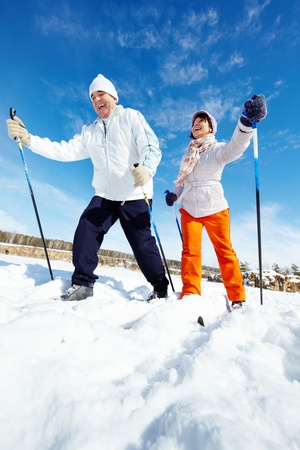 moving activity: Portrait of happy mature couple skiing outside Stock Photo