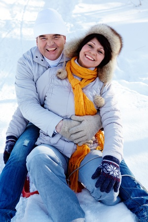 Portrait of happy mature couple having fun in winter photo