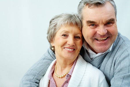 Portrait of attractive middle woman and man looking at camera  photo